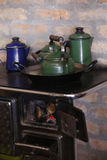 Wood burning stove with cooffe Royalty Free Stock Image