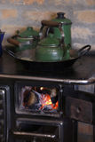 Wood burning stove with cooffe Stock Photos