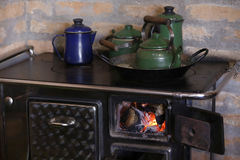 Wood burning stove with cooffe Royalty Free Stock Photos