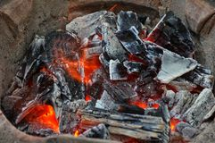 Wood burning in tradition clay stove royalty free stock photos