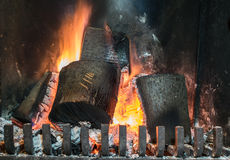 Wood burns in fireplace Stock Image