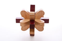 Wood Burr. Two colored wooden burr puzzle assembled on white Stock Image