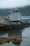 Wood cabin by the fjord Royalty Free Stock Photo