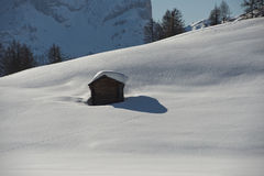 A wood cabin hut in the winter snow background Royalty Free Stock Photo