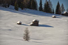 A wood cabin hut in the winter snow background Royalty Free Stock Images