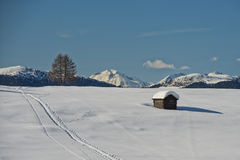 A wood cabin hut in the winter snow background Stock Photography