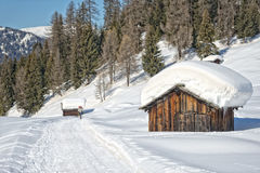 Wood cabin hut in the winter snow background Royalty Free Stock Photography