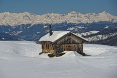 A wood cabin hut in the winter snow background Stock Photos