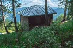 Wood cabin with a metal roof in the middle of the forest of Bulgaria royalty free stock image