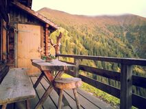 Wood Cabin Patio Overlooking Hillside Stock Image