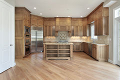 Wood cabinet kitchen. With large island in new construction home Royalty Free Stock Images