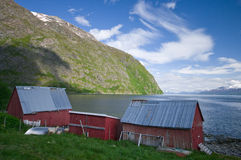 Wood cabins and fjord Stock Photos