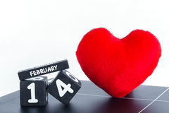 Wood calendar for February 14 with red heart Royalty Free Stock Image