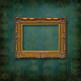 Wood carved baroque frame on Victorian wall. Vintage frame on faded grunge stylized texture stock images