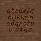 Wood carved font. Wood texture and carved font set Stock Images