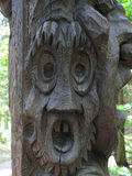Wood carved frightened face. Stock Photos