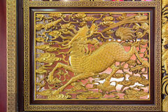 Wood Carved Qilin on Chinese Temple Wall Royalty Free Stock Images