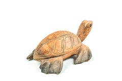 Wood carved turtle on white background Royalty Free Stock Photo