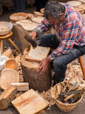Wood Carver Craftsman Working. Skilled male craftsman making bowls from logs by hand, using traditional tools and methods. Ludlow, Shropshire, England, UK Stock Image