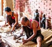 Wood carver in Mandalay, Myanmar 1. MANDALAY MAY 23: Wood carvers do their work in souvenir factory in Mandalay, Myanmar on May 23, 2014. Mandalay is the stock photo