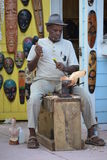 Wood carver. A wood carver on a tropical island Royalty Free Stock Photos