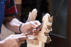 Wood carver at work stock image