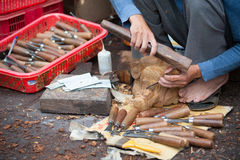 Wood carver at work Royalty Free Stock Images