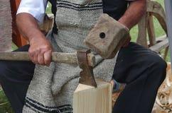 Wood carver at work. Traditional craftsman carving wood. Sumuleu, Transylvania. Photo taken on: July 04. 2015 royalty free stock photography