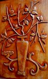 Wood carving 3. A wood carving on a wood door Royalty Free Stock Photos