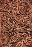 Wood carving. A closeup of the intricate vine design carved onto a piece of wood Royalty Free Stock Image
