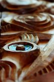 Wood carving. With paua shell Stock Images