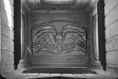 Wood carving angel. Bas-relief stock images