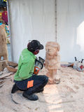 Wood carving artist at work Stock Images