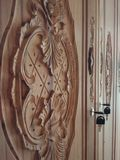 Wood carving. Wood carved with flower and leaves shape Royalty Free Stock Photo