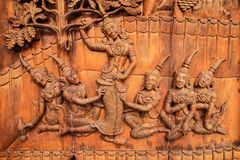 Wood-carving Concubine. On the temple door Royalty Free Stock Photos