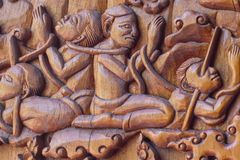a wood carving depictiong image on the wall of temple in thailand, Thai striped royalty free stock images