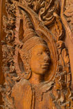 Wood carving for deva statue Stock Images