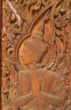 Wood carving for deva statue Stock Photo