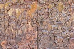Wood carving door Buddha Stock Image