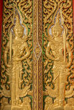 Wood carving door decorated with stained glass in the temple Stock Image