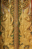 Wood carving door decorated with stained glass in the temple Royalty Free Stock Photography