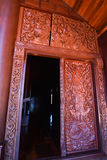 Wood-carving on door. Section of an ancient mural Thailand wood carving in temple royalty free stock image