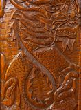 Wood carving of a dragon Stock Image