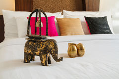Wood carving elephant on white bed Stock Images