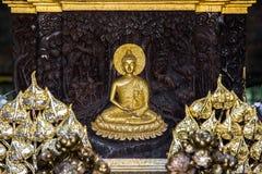 Wood Carving of Gilded Buddha under Bodhi tree at Wat Phra Kaeo - Chiang Rai, Thailand. Wood Carving of Gilded Buddha under Bodhi tree at Wat Phra Kaeo in Chiang stock photos