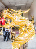 Wood carving of golden color dragon Royalty Free Stock Image