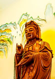 Wood carving of Guan yin Stock Photos