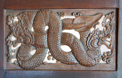 Wood carving of nagas Stock Image