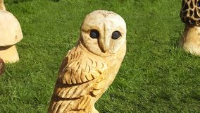 Wood carving of an Owl with a chainsaw, hammers and. Wood carving of an Owl with a chainsaw hammers and chisel stock photos