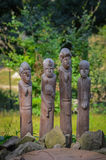 Wood carving of primitive various African men Royalty Free Stock Photos